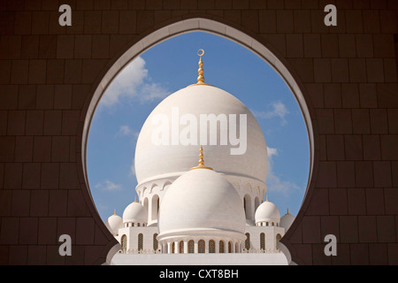 View Through A Round Window Towards The Domes Of Sheikh Zayed Mosque Stock Photo Royalty Free
