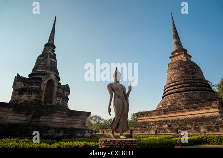Walking Buddha statue in Wat Sa Si or Sra Sri temple, Sukhothai Historical Park, UNESCO World Heritage Site, Northern - Stock Photo