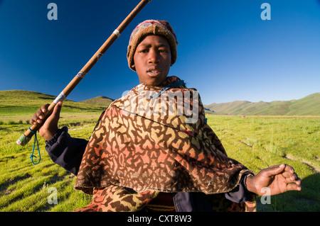 Young Basotho man wearing a traditional costume, shepherd, portrait, Drakensberg, Kingdom of Lesotho, southern Africa - Stock Photo