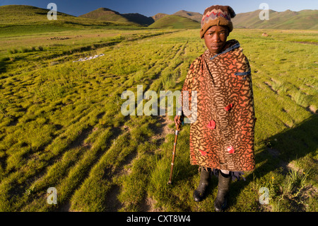 Young Basotho man wearing a traditional costume, shepherd, Drakensberg, Kingdom of Lesotho, southern Africa - Stock Photo