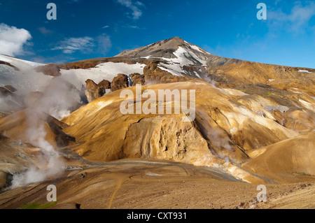Hot springs and snow-capped Rhyolite Mountains, Hveradallir high temperature region, Kerlingarfjoell, highlands, - Stock Photo