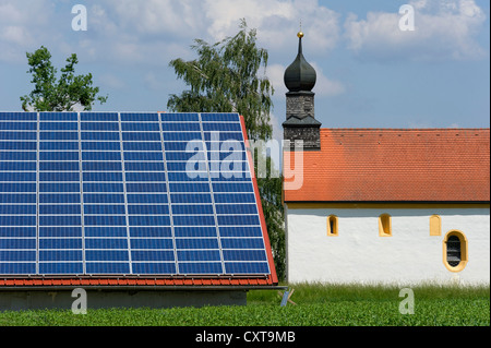 Photovoltaic system, solar power station on the roof of a farm building near Plattling, Lower Bavaria, Bavaria - Stock Photo