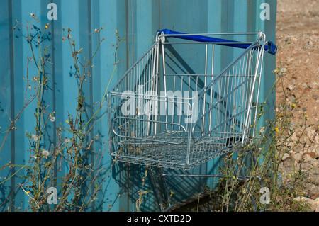 Abandoned supermarket shopping trolley England UK United Kingdom GB Great Britain - Stock Photo
