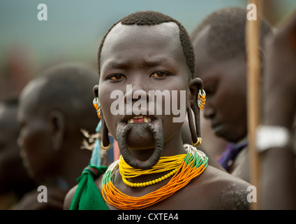 Suri Tribe Woman With Enlarged Lip At A ceremony organized by the government, Kibish, Omo Valley, Ethiopia - Stock Photo