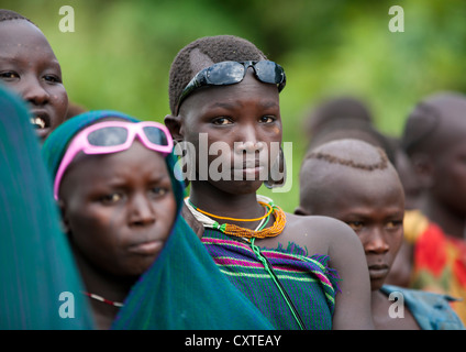 Suri Tribe Girls At A ceremony organized by the government, Kibish, Omo Valley, Ethiopia - Stock Photo