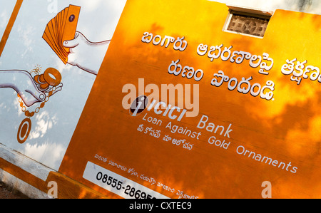 Indian gold loan advertisement painted on a house wall. Andhra Pradesh, India - Stock Photo