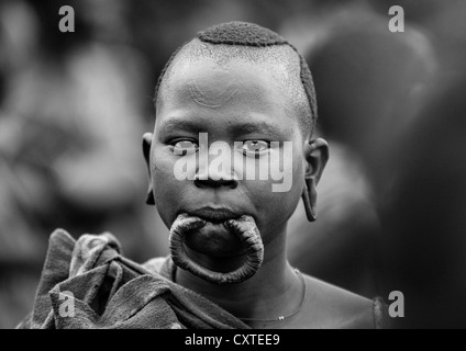 Suri Tribe Girl With An Enlarged Lip at a Ceremony Organized By The Government, Kibish, Omo Valley, Ethiopia - Stock Photo