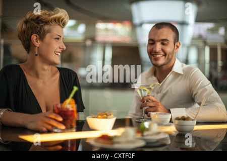 Couple having drinks at bar - Stock Photo