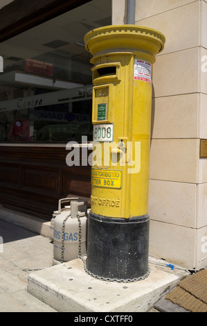 dh Postbox POST CYPRUS Old British yellow pillarbox - Stock Photo