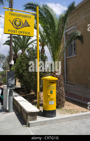 dh  NICOSIA CYPRUS Lefkosia South Cyrpus Post Office signpost and Cypriot yellow pillarbox - Stock Photo