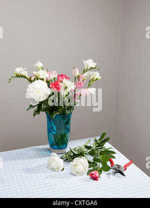 Cut flowers with bouquet in vase - Stock Photo