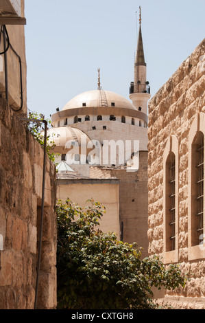 Madaba Mosque through the buildings, Jordan - Stock Photo