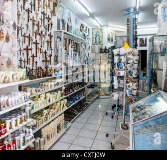 Shop selling religious souvenirs in Lourdes, Hautes Pyrenees, France - Stock Photo