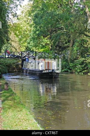 60' narrowboat 'Blythe Valley' leaves Lock No. 34  on the Stratford-upon-Avon Canal near Yarningale, Warwickshire, - Stock Photo