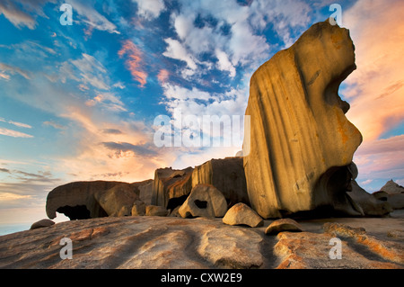 Remarkable Rocks under colourful clouds at sunrise. - Stock Photo