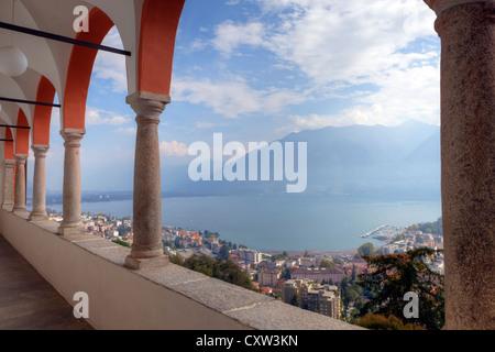 Overlooking Lake Maggiore by the arches of the Sanctuary of Madonna del Sasso, Locarno, Ticino, Switzerland - Stock Photo