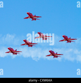 Red Arrows in formation at WESTON-SUPER-MARE, SOMERSET-JULY 23RD 2012: At the Grand Pier Air Show - Stock Photo