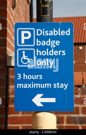 A disabled parking sign in a car park in the U.K. - Stock Photo