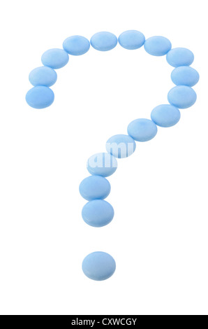 Question mark from blue pills isolated on white - Stock Photo