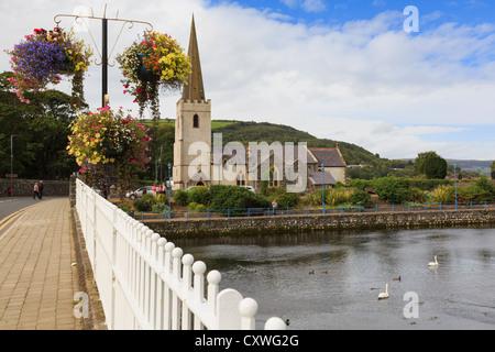 A2 Causeway Coast road bridge over Glenarm River with St Patrick's church in Glenarm, County Antrim, Northern Ireland, - Stock Photo