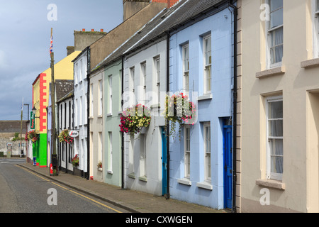 Row of traditional colourful terraced houses on street in characteristic Irish village of Glenarm, County Antrim, - Stock Photo