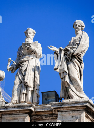 Statues atop of Saint Peter's Basilica, Vatican City, Rome, Italy. - Stock Photo
