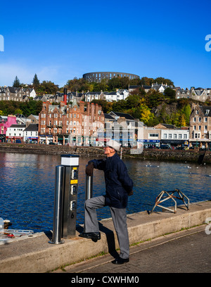 Oban from the harbour with McCaig's Tower on the hill, Oban, Argyll, Scotland. - Stock Photo
