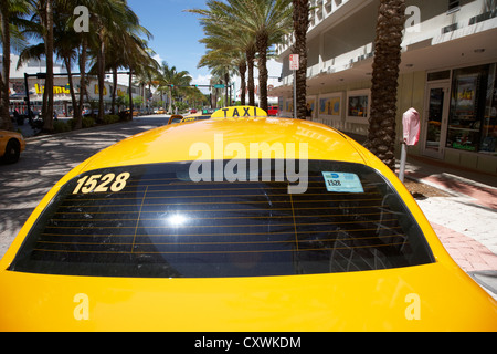 rooftop taxi sign on cab in row of yellow cab taxis in miami south beach florida usa - Stock Photo