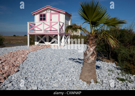 At Gruissan beach (Aude - France), the funny scale model of a white and pink chalet which can be seen in the film - Stock Photo