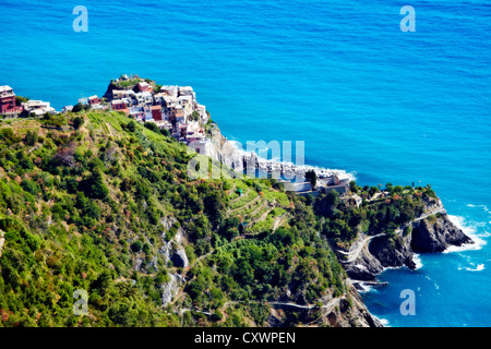 Aerial view of coastal city on hillside - Stock Photo