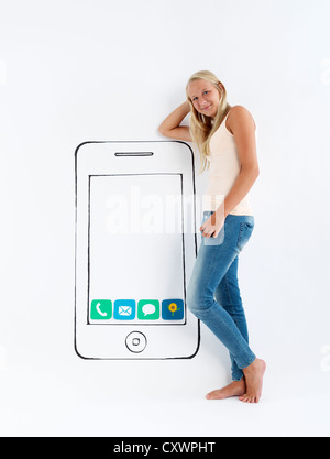 Girl standing by drawing of smartphone - Stock Photo