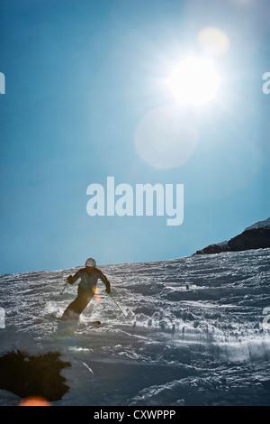 Skier coasting on snowy slope - Stock Photo
