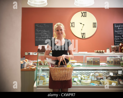 Woman shopping in grocery store - Stock Photo