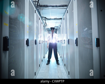Security guard in server room - Stock Photo