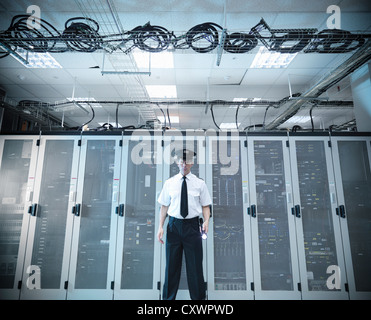 Security guard standing in server room - Stock Photo