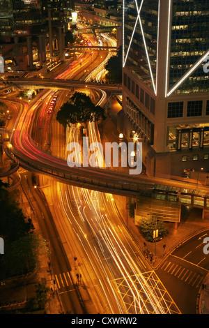 Time lapse view of urban traffic - Stock Photo