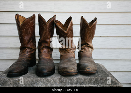 Close up of worn cowboy boots - Stock Photo