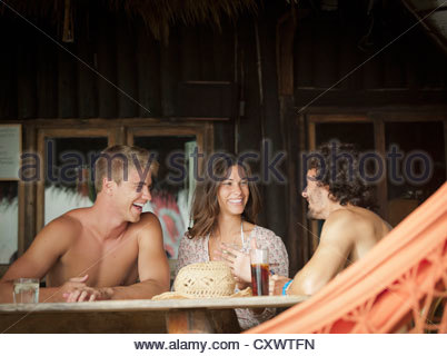 Friends having drinks together - Stock Photo