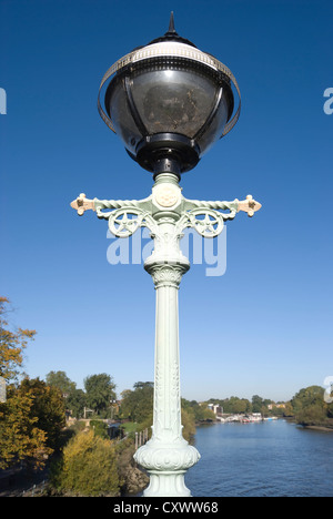 lamp on richmond lock footpath, on the river thames at richmond, surrey, england, with view towards isleworth, middlesex - Stock Photo