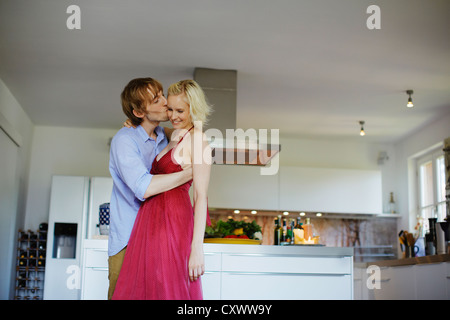 Couple dancing together in kitchen - Stock Photo