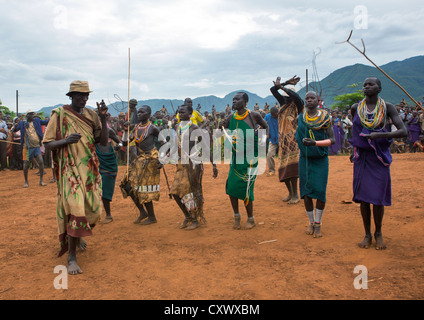 Suri Tribe People Dancing At A ceremony organized by the government, Kibish, Omo Valley, Ethiopia - Stock Photo