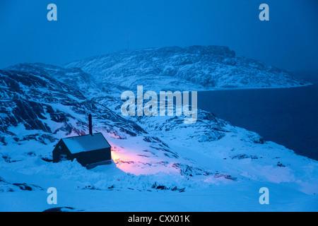Winter scene near Kulusuk village, Greenland - Stock Photo