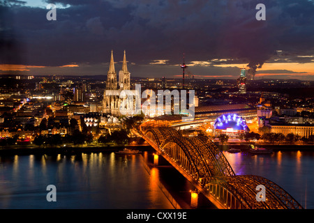 City view of Cologne at night with Cologne Cathedral, Rhine River, Musical Dome and Hohenzollern Bridge, Cologne, - Stock Photo