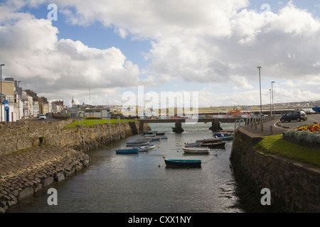 Portrush County Antrim Northern Ireland Rowing boats moored in the harbour - Stock Photo