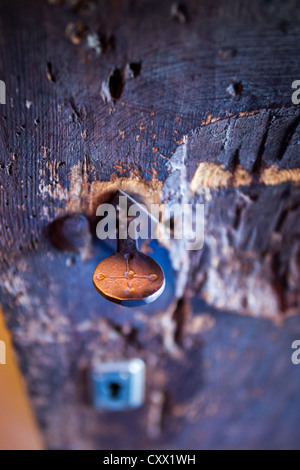 Key in the door of Romanesque church Santa Eulàlia in Erill la Vall in Vall de Boí, Catalonia, Spain. - Stock Photo