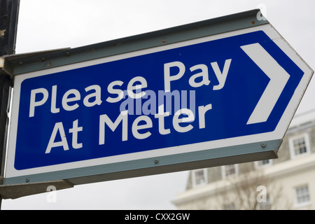 Please Pay At Meter sign in a car park, Pay here, UK - Stock Photo