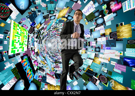 Asian businessman surrounded by science images - Stock Photo