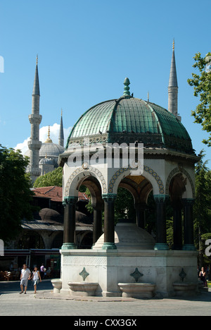 ISTANBUL, TURKEY. The Kaiser Wilhelm II fountain on the Hippodrome in Sultanahmet district, with the Blue Mosque - Stock Photo