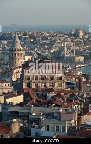 ISTANBUL, TURKEY. An evening view across the rooftops of Beyoglu towards Eminonu and Sultanahmet. 2012. - Stock Photo
