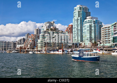Granville Island Ferry leaving traveling between the waterfront of Vancouver, British Colombia and Granville Island. - Stock Photo